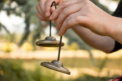 The bell is used to help with focus and attention in mindfulness practice